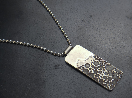 Denise Harrison's beer inspired pendant.
